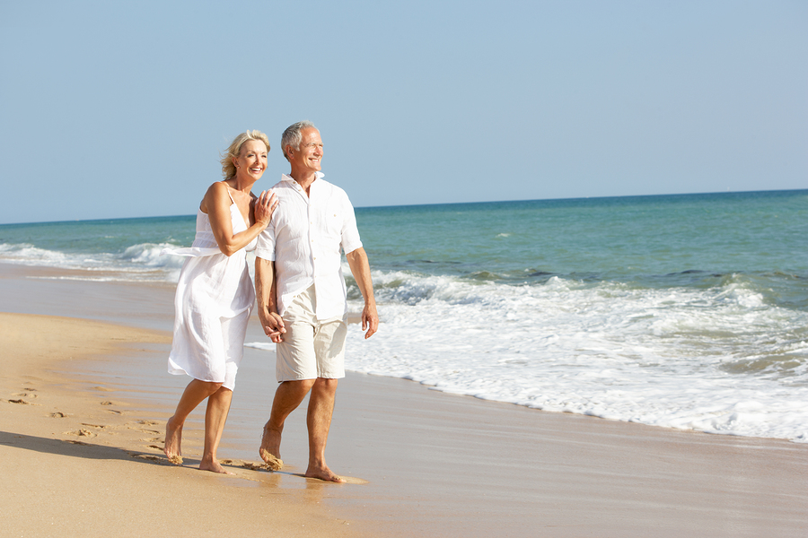 Senior Couple Enjoying Beach Holiday: Senior Couple Enjoying Beach Holiday